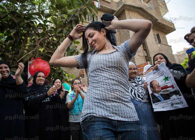 صور رقص بنات 2014 في الإنتخابات المصرية تأييداً للسيسي وصباحي