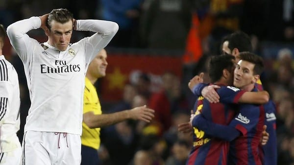 """Real Madrid's Gareth Bale (L) reacts as Barcelona's Lionel Messi (R) celebrates with team mates at the end of their Spanish first division """"Clasico"""" soccer match against Barcelona at Camp Nou stadium in Barcelona, March 22, 2015. Barcelona won 2-0.         REUTERS/Paul Hanna"""