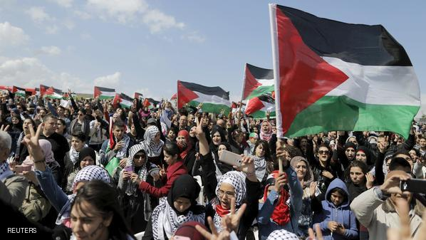 Israeli Arabs and other supporters wave Palestinian flags as they march during a protest to mark the right of return for refugees who fled their homes during the 1948 war, near Tiberias in northern Israel April 23, 2015. The 1948 war followed the creation of Israel, which celebrated its 67th Independence Day on Thursday. REUTERS/Ammar Awad
